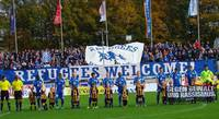 "Fußballstadion in Oldenburg mit Fan-Initiative und Banner ""Refugees Welcome"""